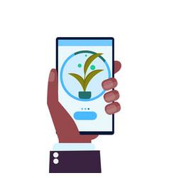 Human hand using mobile app smart control farming vector