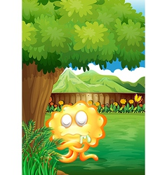 A yellow monster under the tree in the gated yard vector image