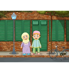 Muslim couple standing on the sidewalk vector