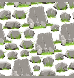 Cartoon stones with grass seamless pattern vector