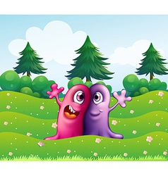 Two adorable one-eyed monsters near pine trees vector