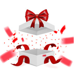 Realistic surprise gift box with falling confetti vector
