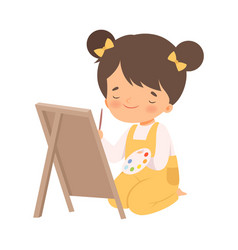 Cute girl sitting on floor and drawing picture vector
