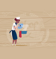 Female african american chef cook holding pot vector