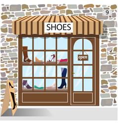 shoes shop building facade of stone vector image vector image