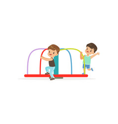 two preschool boys playing on rotating roundabout vector image