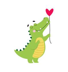 Cute crocodile holding heart shaped balloon funny vector