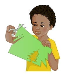 African American boy cuts paper with scissors vector image