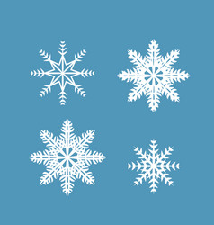set of 4 snowflakes on a blue background vector image