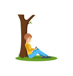 boy listening to music near tree in the park vector image