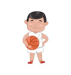 little boy in basketball uniform holding ball vector image