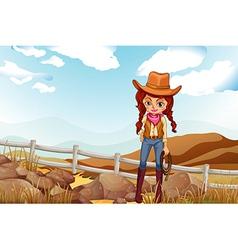 A pretty cowgirl near the rocks vector