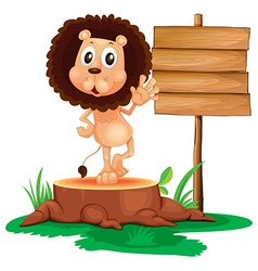 A lion above a trunk beside a wooden signboard vector image