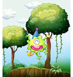 A monster playing near the tree in the forest vector image