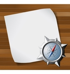 Compass and paper over wooden background vector