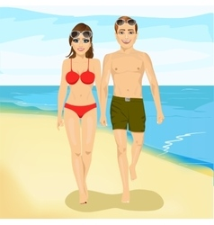 happy couple walking along a beach vector image