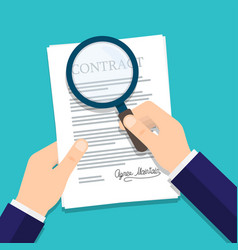 Hand holding magnifying glass over a contract vector