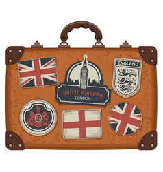 Suitcase with uk and english symbols and flags vector