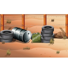 Wheels and fuel containers near the barbwire fence vector