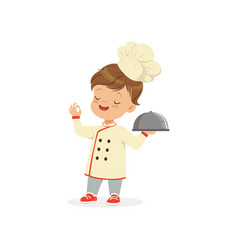 Cartoon character of boy in chef uniform and hat vector