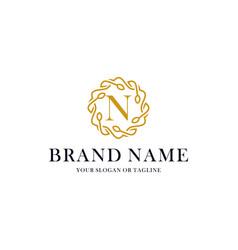 Initial letter n luxury ornament logo design vector