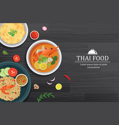 Tom yum kung in the bowl on black wood table top vector
