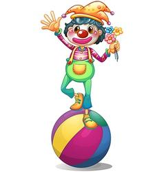 A clown balancing above a ball vector image