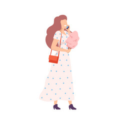 Young woman eating pink cotton candy in park vector