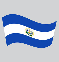 Flag of el salvador waving on gray background vector