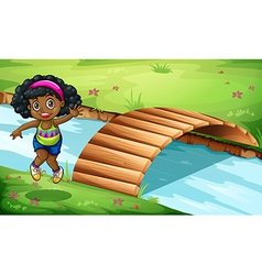 A young Black girl near the wooden bridge vector