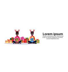 african american couple deer horns sitting lotus vector image