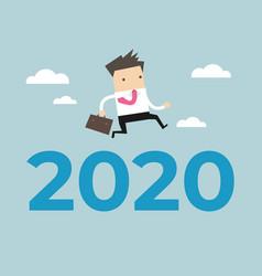 businessman jump over number 2020 vector image