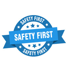 safety first ribbon safety first round blue sign vector image