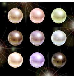 Shinyl pearls on black background set vector