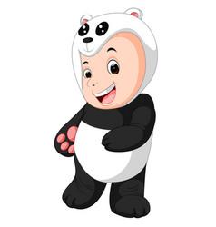 Cute baby boy wearing a panda bear suit vector