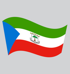 Flag of equatorial guinea waving gray background vector