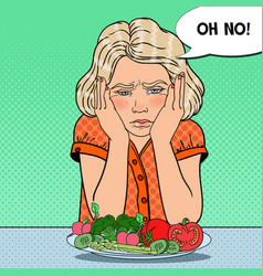 Pop art upset child with plate of fresh vegetables vector