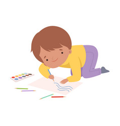 cute boy sitting on floor and drawing picture vector image