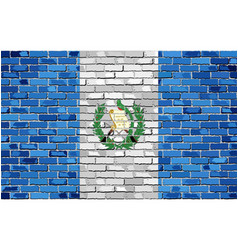Flag of guatemala on a brick wall vector