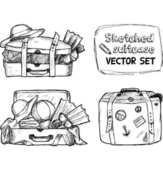 Hand-drawn suitcase sketches set vector