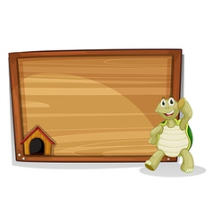 A turtle beside a wooden empty board vector image