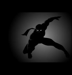 Silhouette a masked superhero vector
