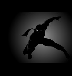 Silhouette of a masked superhero vector