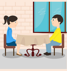 young romantic couple sitting at the table vector image
