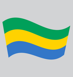 flag of gabon waving on gray background vector image vector image