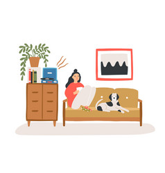 young woman sitting on cozy sofa with her dog vector image