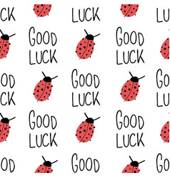 Ladybug and good luck hand drawn lettering on vector