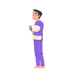 Slumber party boy in pajamas standing with pillow vector
