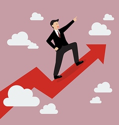 Businessman standing on a growing graph vector image