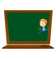 An empty blackboard with a boy hanging vector